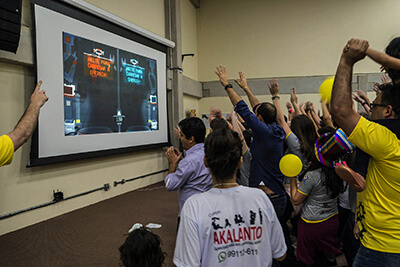 People interacting in an event with Cyber Factory Game