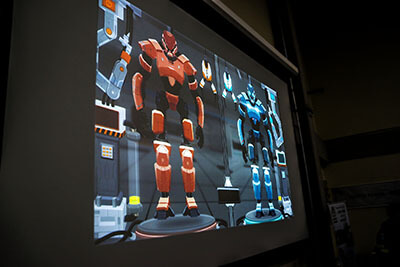 Cyber Factory game in a projection screen